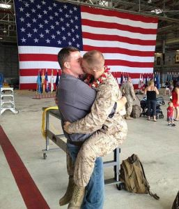 Sgt. Brandon Morgan with boyfriend Dalan Wells kissing